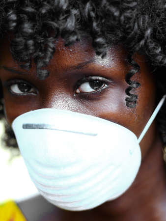 Portrait of African Woman Wearing Face Mask Against Infection of Bacterira, Virus