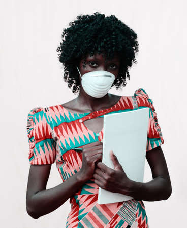 African Body Shot of Doctor Woman Posing with Facemask and Notebook