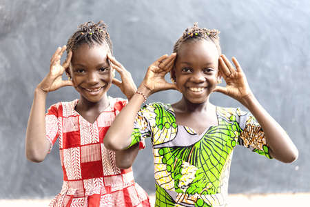 Having Fun Playing with Hand Gestures. Beautiful African Black Ethnicity Children Posing for the Camera