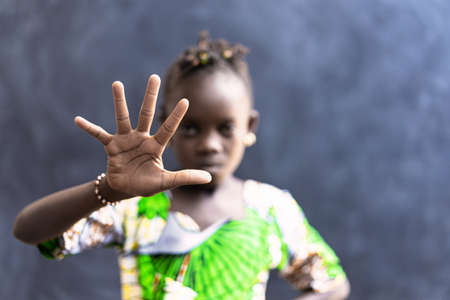 Stop to Racism and Discrimination! African Girl Showing Hand in Stop Symbol with Fingers Archivio Fotografico
