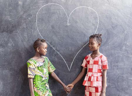 Gorgeous Black African Cute Girls Posing Together Looking Smiling Zdjęcie Seryjne