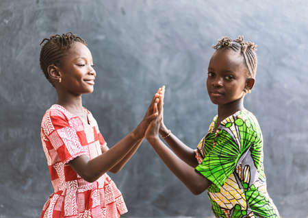 African Black Children Playing with Hands Smiling