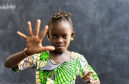 Portrait of African Black Girl Child Showing Palm of Hand as stop discrimination and racism Archivio Fotografico