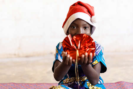 Cute Black African Christmas Girl Showing Present with Hands Happy and Joyful
