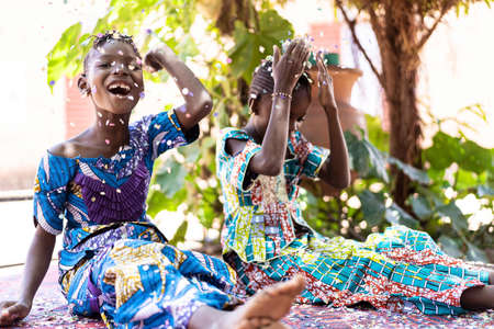 Young African Sisters Having Fun, Enjoying Party with Cheerful and Joyful Expressions