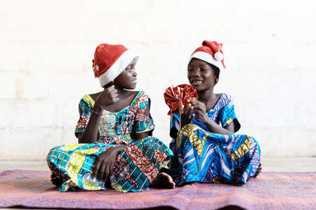 Gorgeous African Christmas Children Wearing Hats and Giving Presents