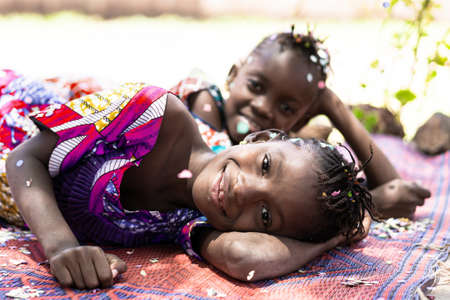 Two African beautiful girls enjoying happy funny active expressions outdoors in Bamako, Mali Archivio Fotografico