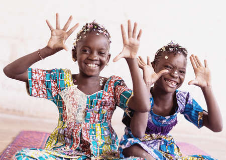 Real African Girls Enjoying Hands Up Throwing Confetti from their hands in a White Room