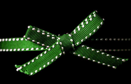 Close up of green ribbon on black background Stock Photo - 3915642