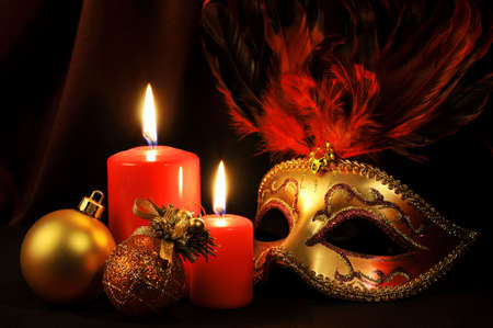 Christmas tree decoration with candles and mask photo