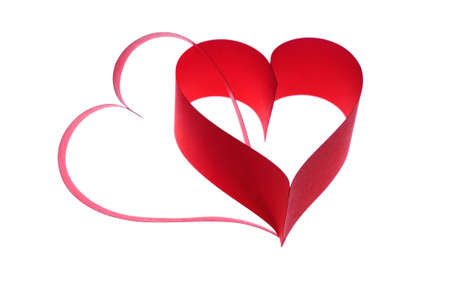 Two red hearts on white background photo