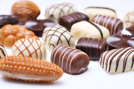 Chocolates isolated on white background photo