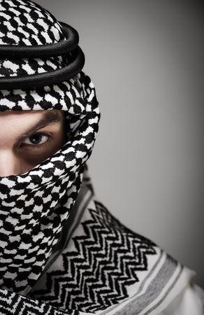 bedouin: Half face of young spiritual Muslim man.