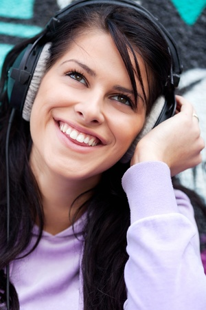 Young beautiful woman enjoying music.  Stock Photo - 8519459