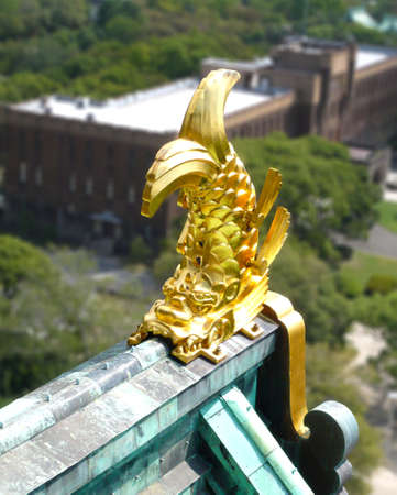 Gold fish decorating the roof of the Japanese temple and personifies perseverance and strength.