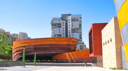 Exhibition hall of modern art and design, made of large metal elements covered with decorative rust of different shades.