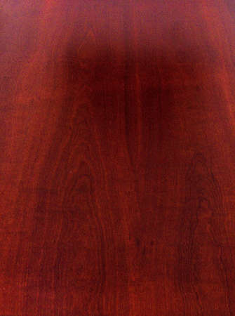 Mahogany is a kind of wood—the straight-grained, reddish-brown timber of three tropical hardwood species of the genus Swietenia, indigenous to the Americas and part of the pantropical chinaberry family, Meliaceae.