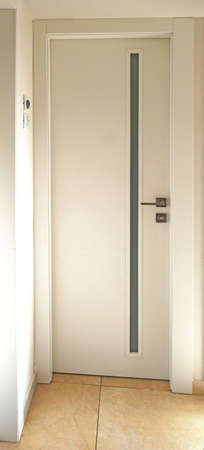 A door in an apartment and a house for common areas, for example in a bath or toilet with a small window with a profile, opaque glass.