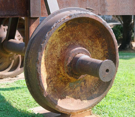 The wheel covered with rust from the car of the old railway.