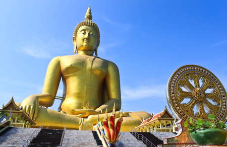 Big Golden Buddhas at Wat Muang, Thailand photo