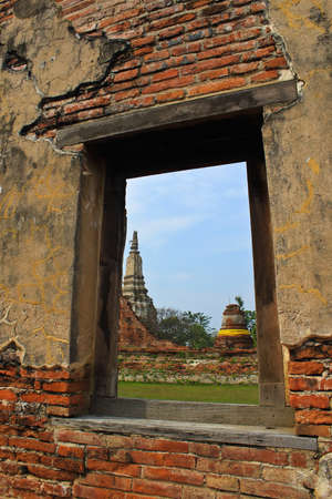 window on old brick wall,Ayuttaya Thailand photo
