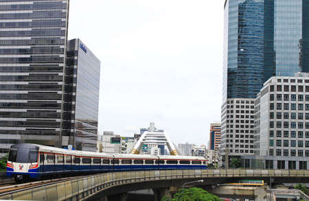 skytrain runs through Sathorn business center on July 07, 2011 in Bangkok