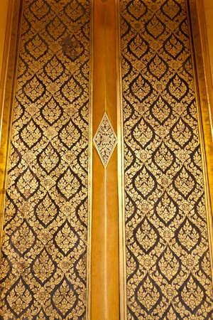 Native Thai style of pattern on door temple Stock Photo