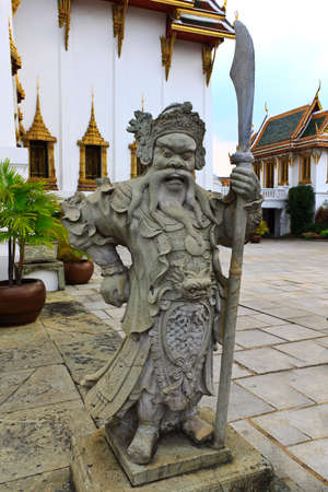 old chinese statue in  the buddhist tample Thailand photo