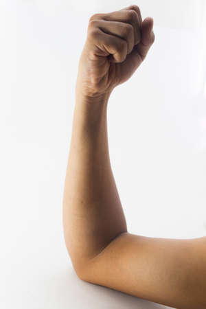 closed fist sign: clenched fist hand closeup white background