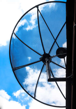 Half Satellite dish with sky background Stock Photo - 14488945