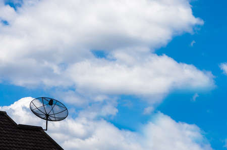Satellite dish with blue sky background Stock Photo - 14488944
