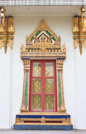 Golden windows of Temple in Bangkok Thailand  Stock Photo