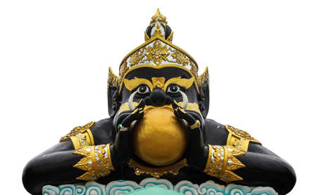 Statue of black deity called Rahu and India god, The black giant eating the moon  photo