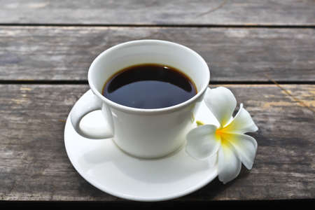 Coffee cup and Frangipani Flower on the wooden table Stock Photo - 15015431