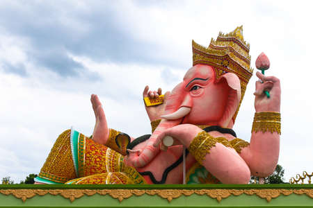 Big pink Ganesha in relaxed pose, Thailand