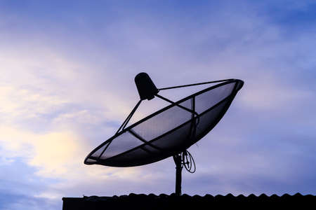 satellite communication disk on evening background photo