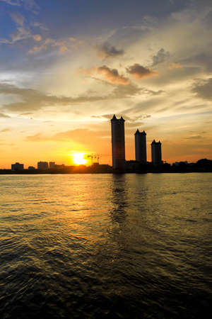 The buildings and sunset on the river at Bangkok Stock Photo - 15497119