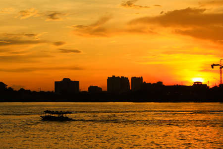 Boat in sunset on the river at Bangkok photo