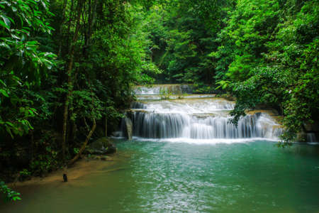 Waterfall and green stream in the forest Thailand photo