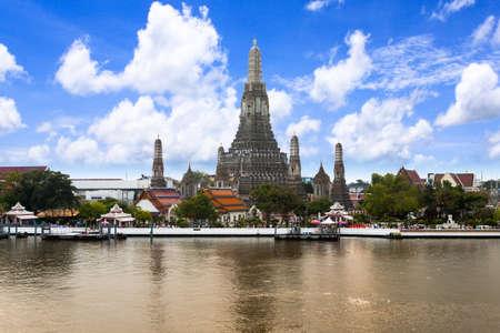 Wat Arun (Temple of Dawn) Across Chao Phraya River With Blue Sky