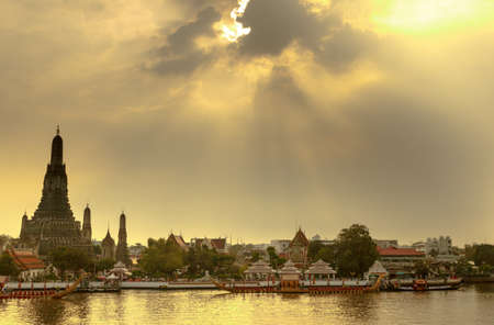 Royal Barge Procession on river in sunset at Wat Arun,Thailand