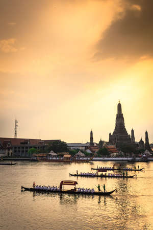 procession: Royal Barge Procession in sunset ,Thailand Stock Photo