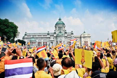 BANGKOK - DECEMBER 5: Thai people sit outside to celebrate for the 85th birthday of HM King Bhumibol Adulyadej on December 5, 2012 in Bangkok, Thailand.