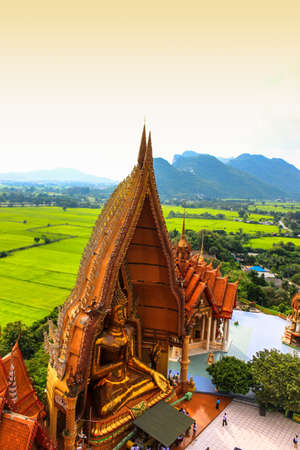 Golden Buddha statue in Kanchanaburi photo