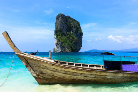 Long tail boats and Tropical paradise island, Andaman Sea, Thailand photo