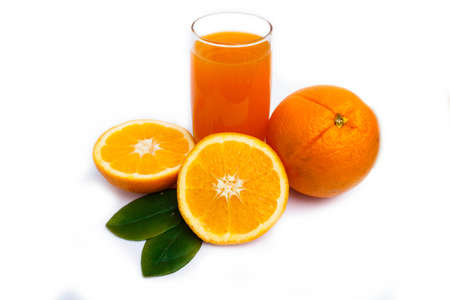 Orange juice and oranges on glass photo