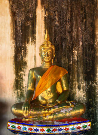 buddha statue on a old brick wall in Thailand Stock Photo