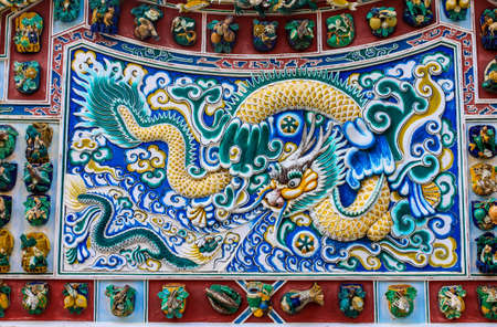 Wall of dragon the Chinese palace at Bang-pa Palace in Ayutthaya, Thailand photo