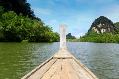 Wooden boat cruise on Mangrove swamp Stock Photo