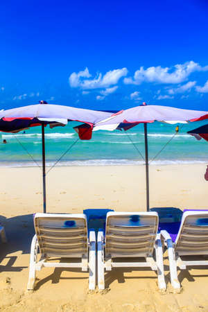 Beach chairs on the white sand beach photo
